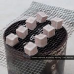 coconut shell charcoal briquettes cubes on fire
